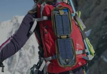 women hiking with backpack and portable solar charger