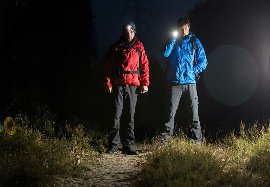 man hiking at night with headlamp on his head
