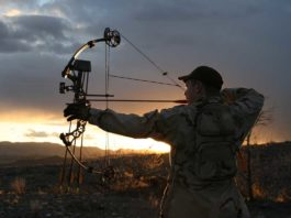 man using new crossbow broadheads while hunting
