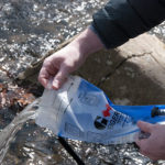 pouring water out of hydration bladder