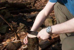 Shrade SCHF51 knife on a wood log