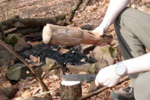 batoning shrade knife with wood log