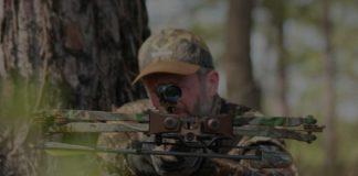man shooting a crossbow