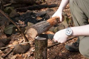 splitting log with shrade knife