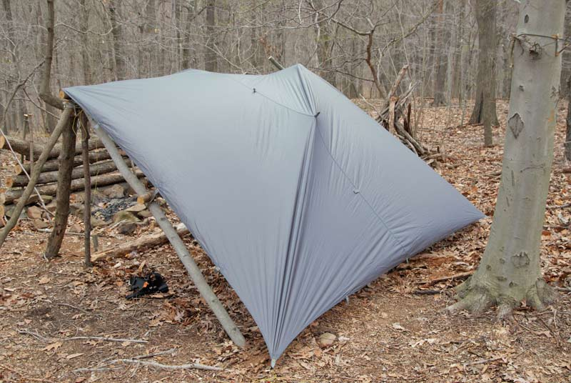 tarp suvival shelter in the woods