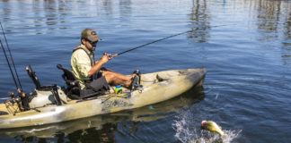 man bass fishing in a hobie kayak