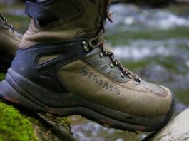 man wearing simms wading boot